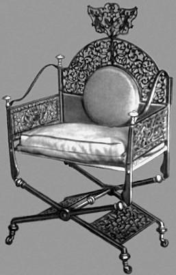 Кресло прорезной стали с золоченой медью. 1740 г.